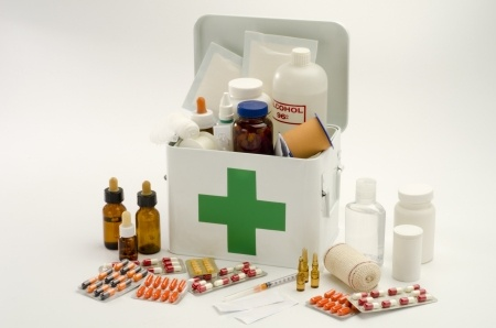 18132836 - open first aid kit filled with medical supplies in white background